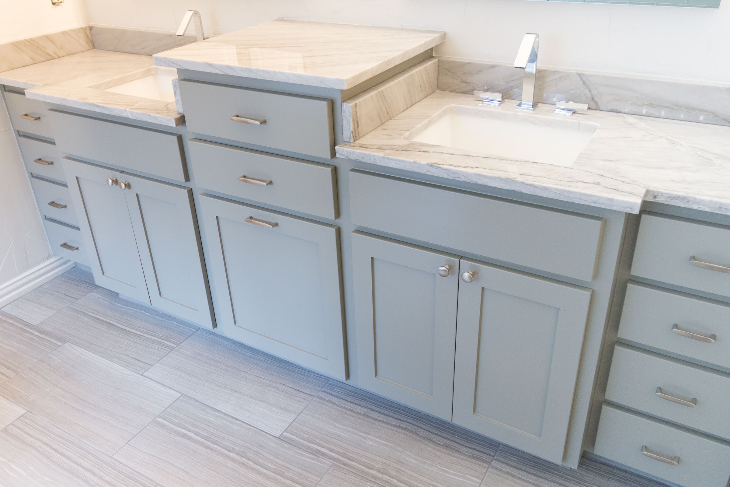 Grey shaker bathroom cabinets, white and grey countertops, grey flooring