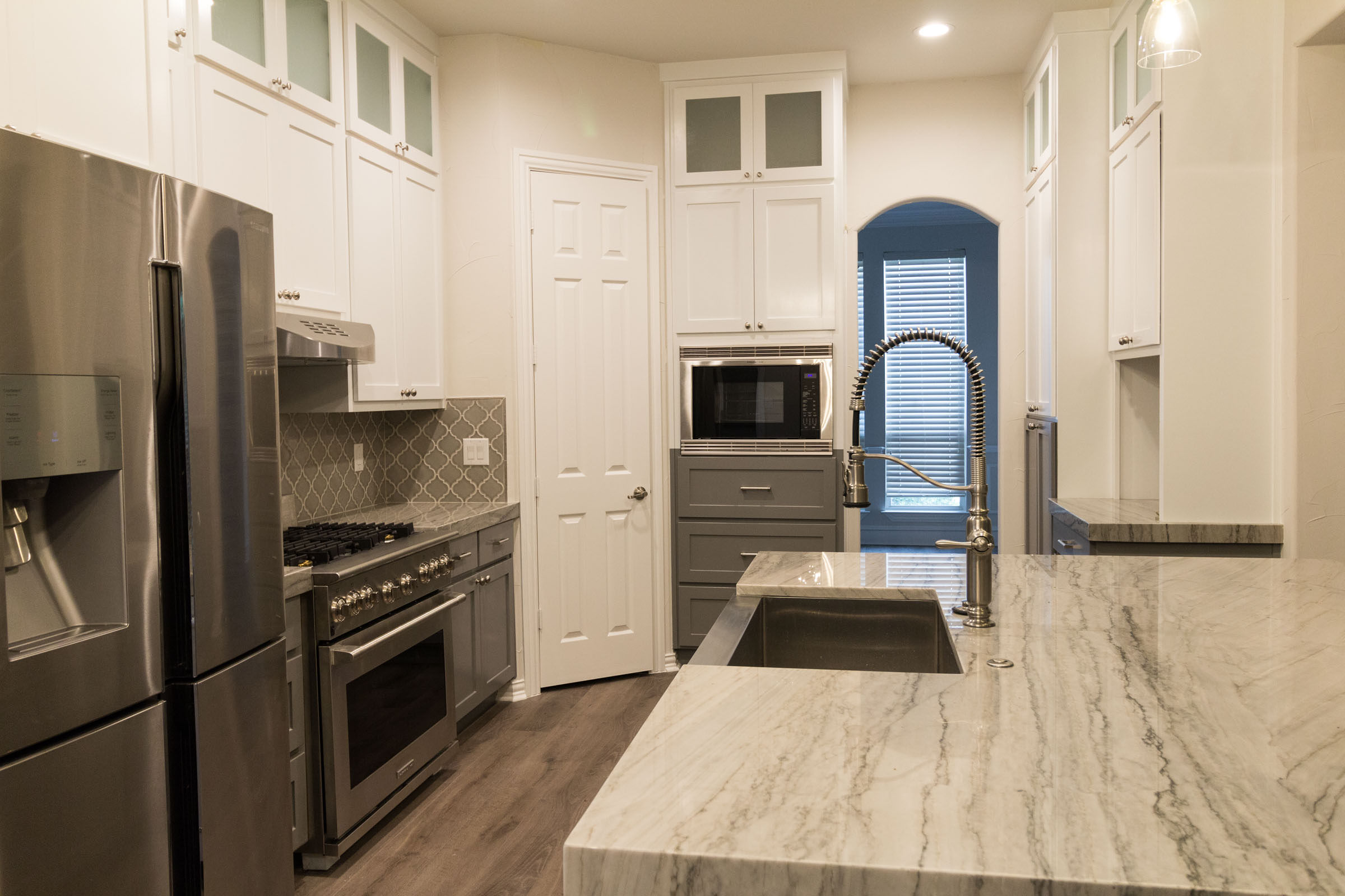 Contemporary kitchen remodel, grey and white, shaker cabinets, stainless steel, farmhouse sink, open floor plan