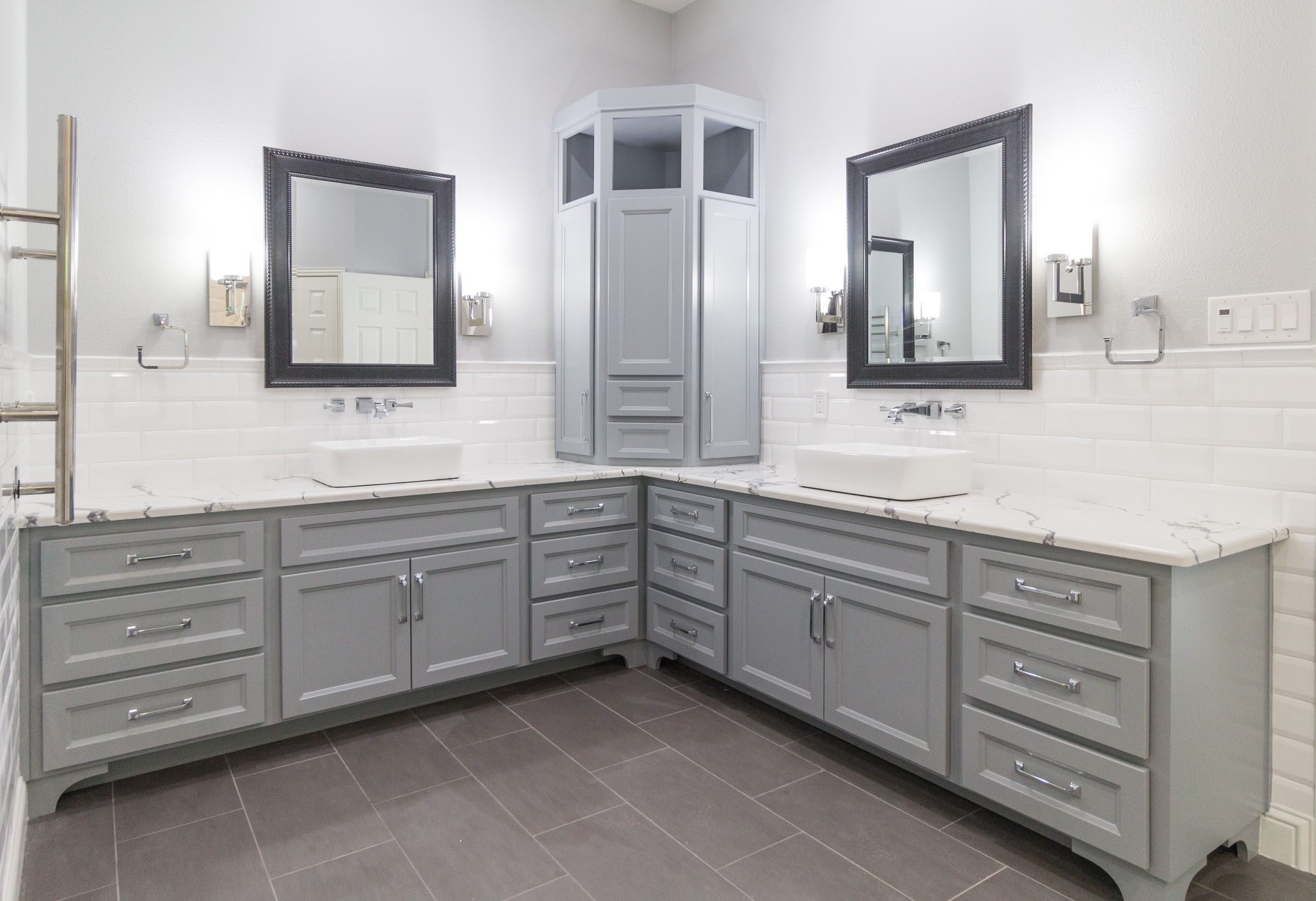 Contemporary bathroom remodel, chrome hardware, white subway tile, grey cabinets, granite countertops, black trimmed mirrors