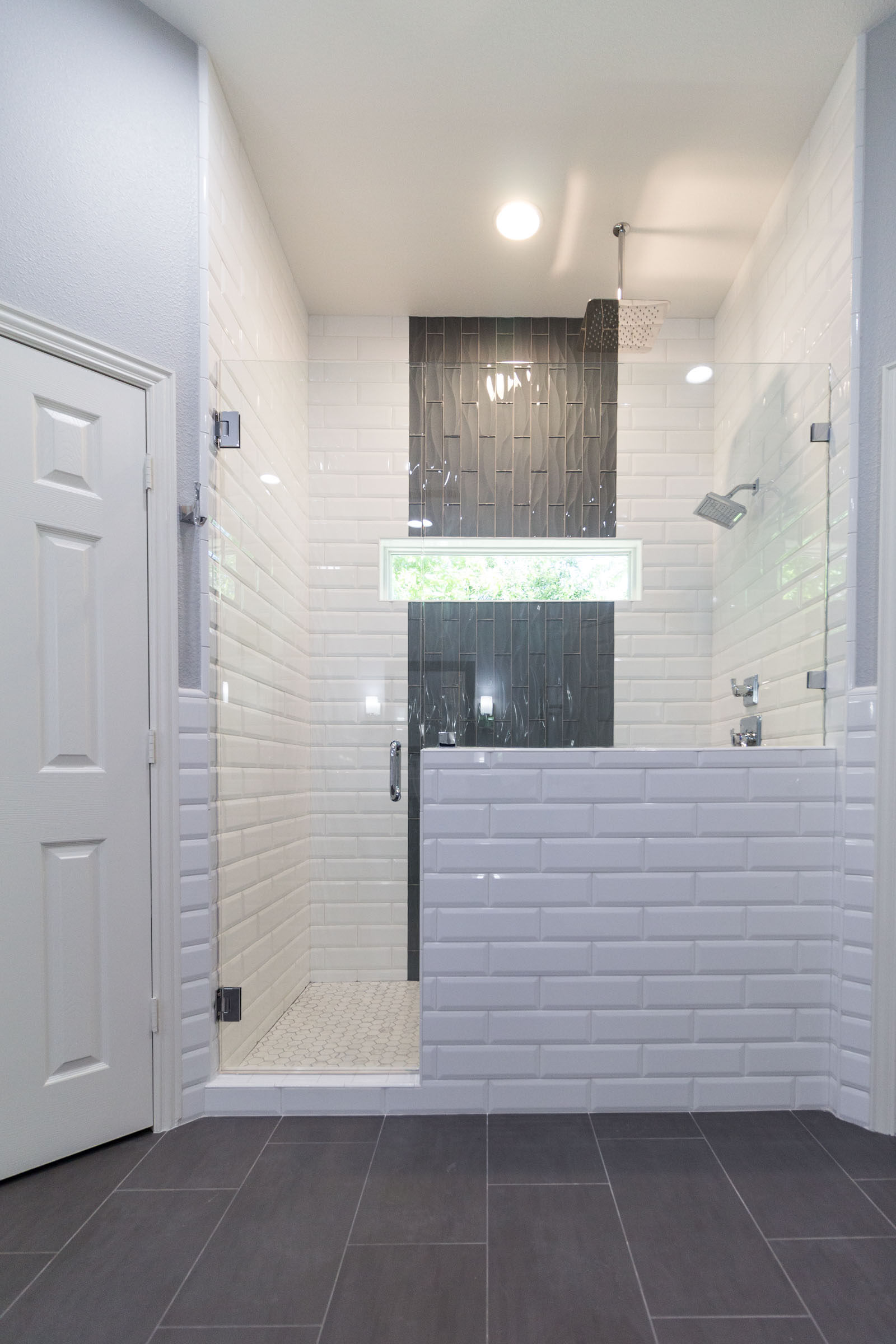 Bathroom remodel with white subway tile and walk in shower