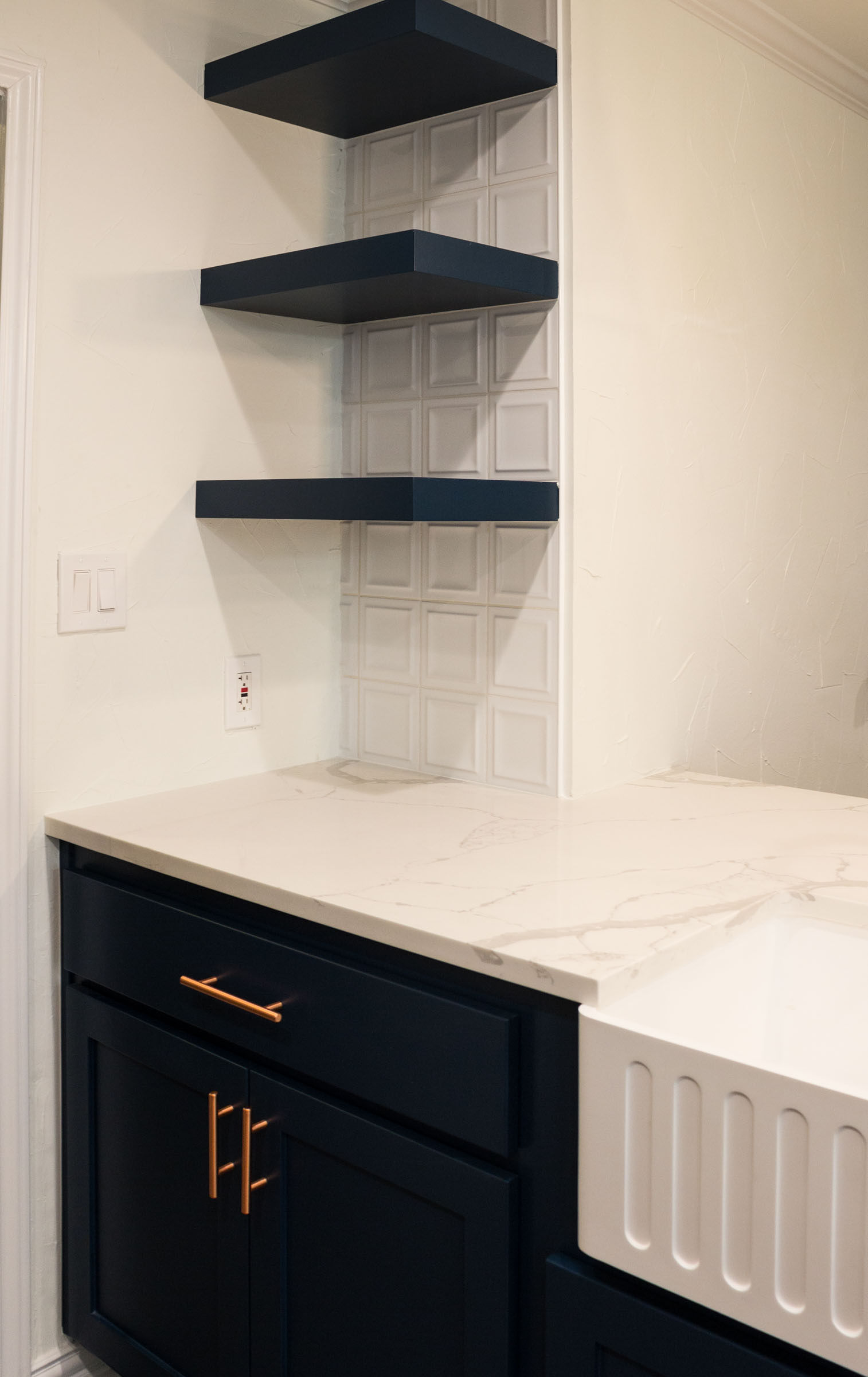 Navy floating shelves, styled kitchen remodel with navy and copper tones