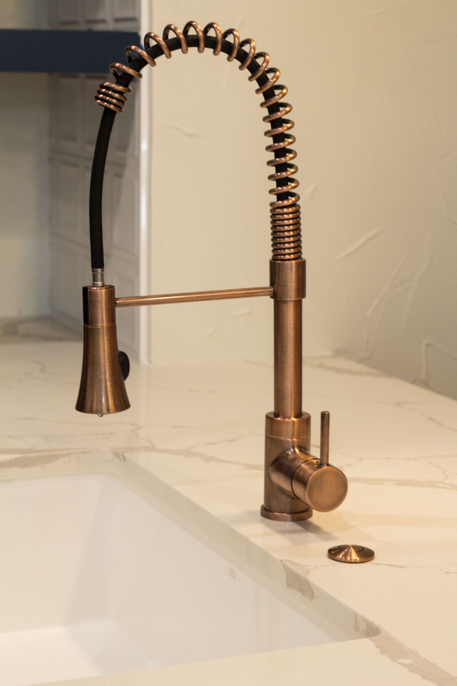 Close up photo of copper swan neck sink faucet