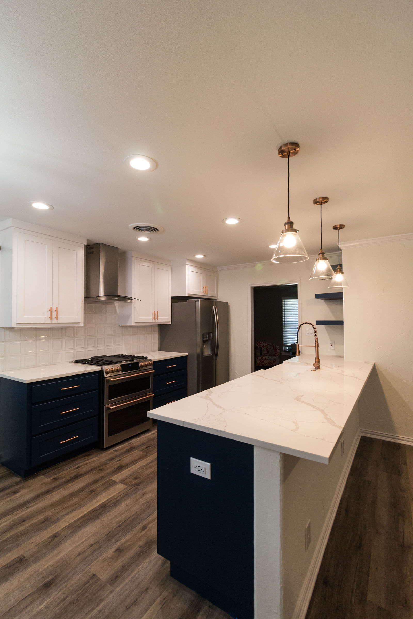 Navy and copper kitchen remodel with spacious bar area