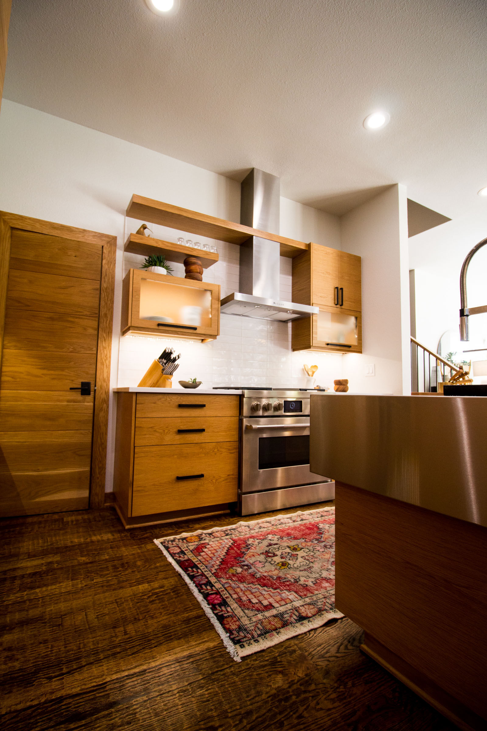 Hard wood floors, blonde cabinets, stainless steel appliances