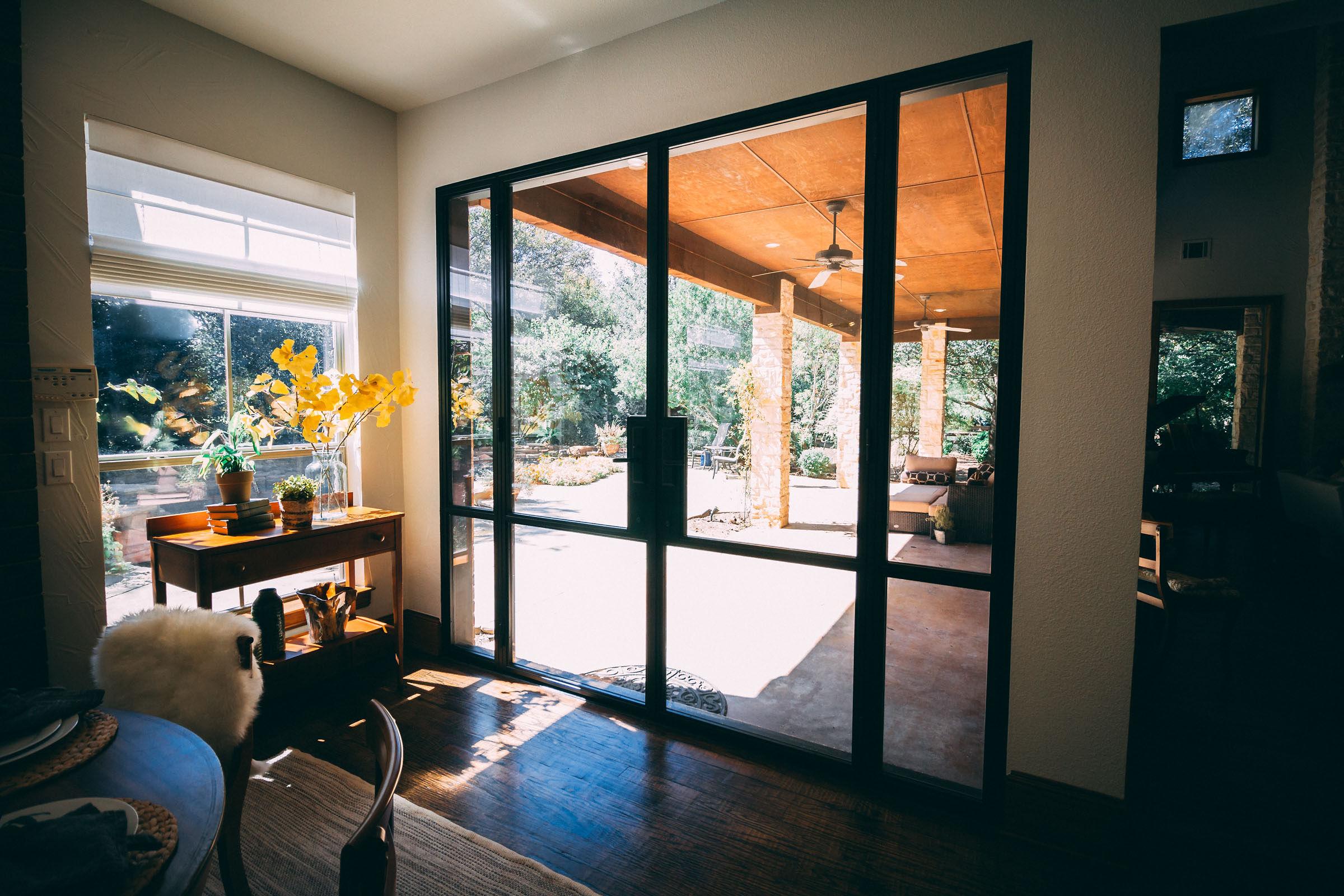 Big, iron trimmed doors opening onto giant patio from kitchen breakfast nook