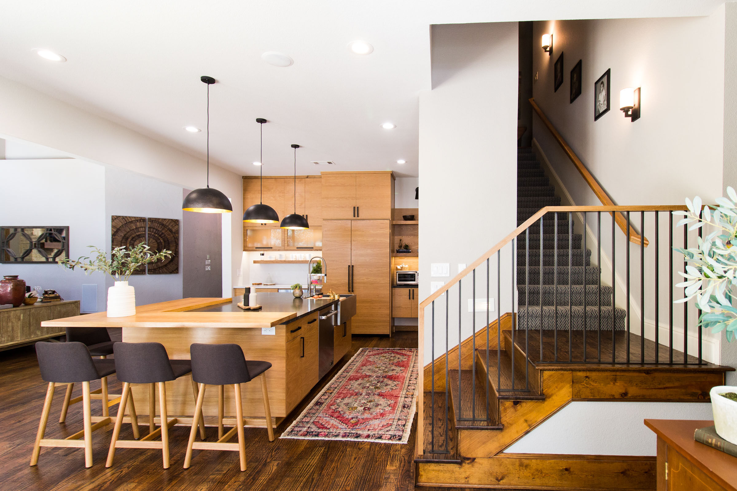 Kitchen remodel with staircase, island, living area, and breakfast nook