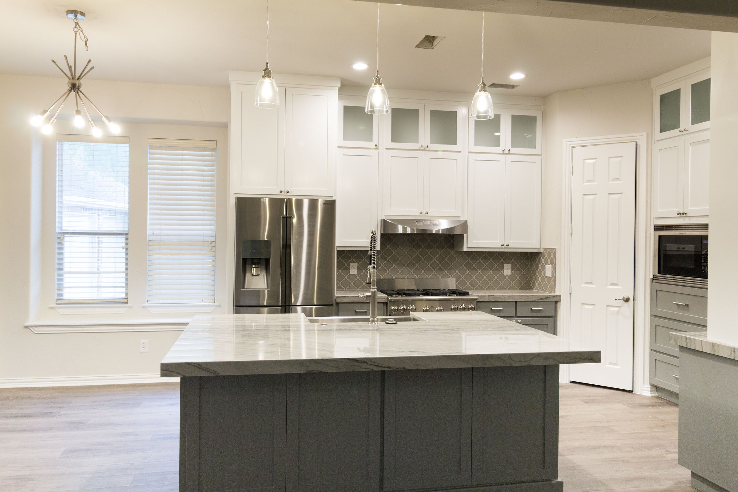 Open floor plan, kitchen remodel, kitchen island, storage and counterspace, white and grey, stunning