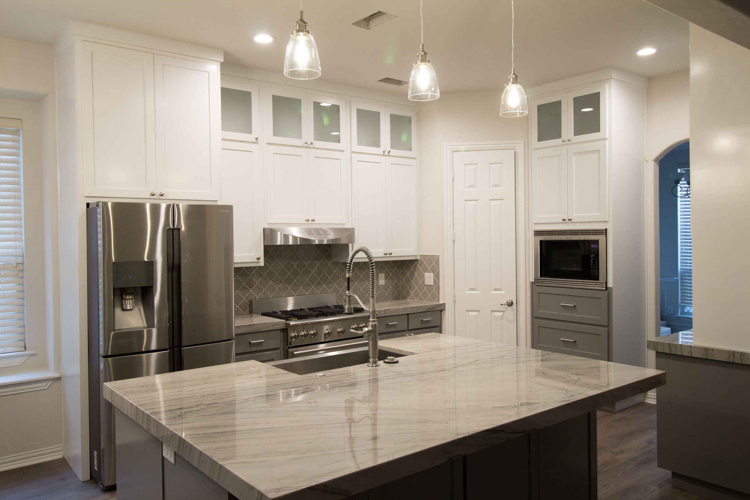 Contemporary kitchen remodel, open concept, kitchen island with sink, spacious and bright