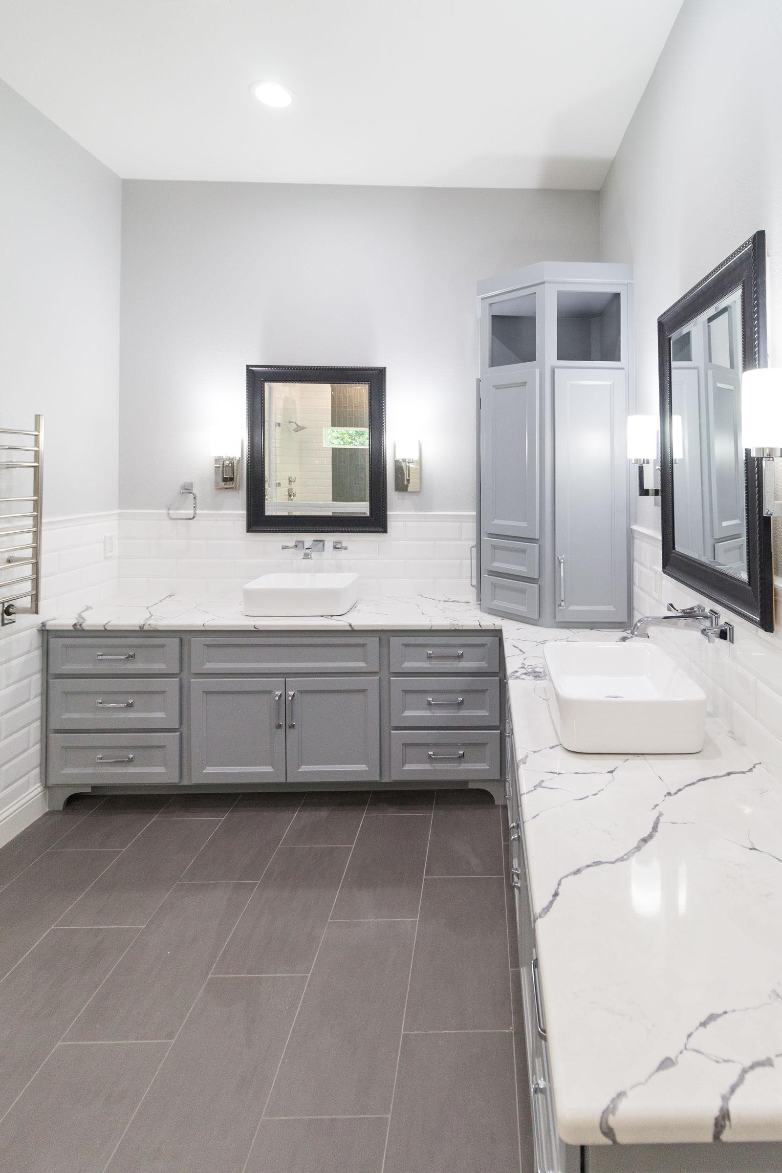 Contemporary bathroom remodel white granite, grey cabinets, clean and bright