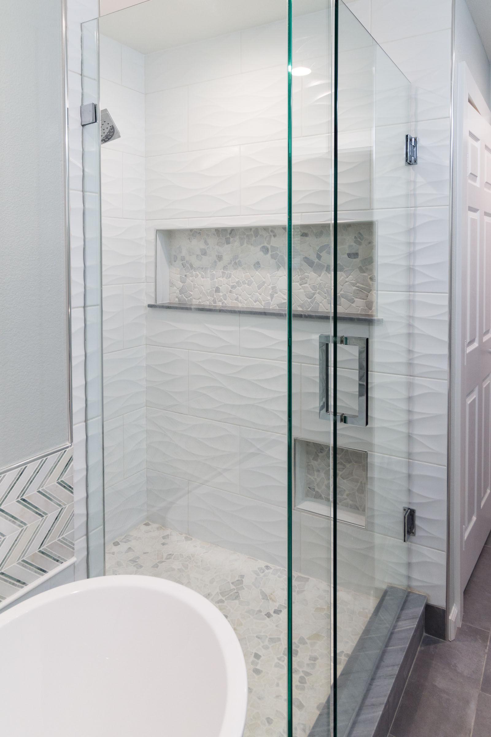 White and grey bathroom remodel, classic tile variations, pedestal tub, walkin shower