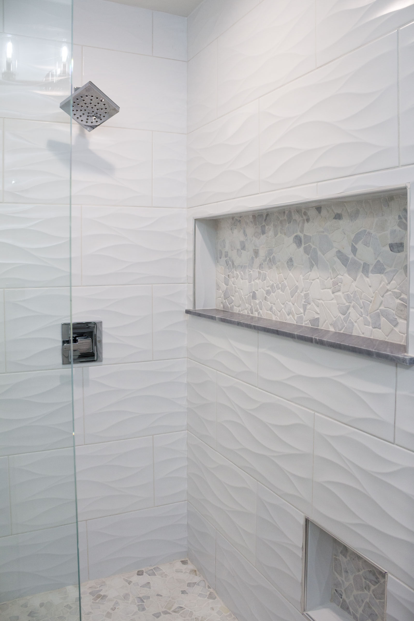 Walk in shower remodel with white tile and niche inserts