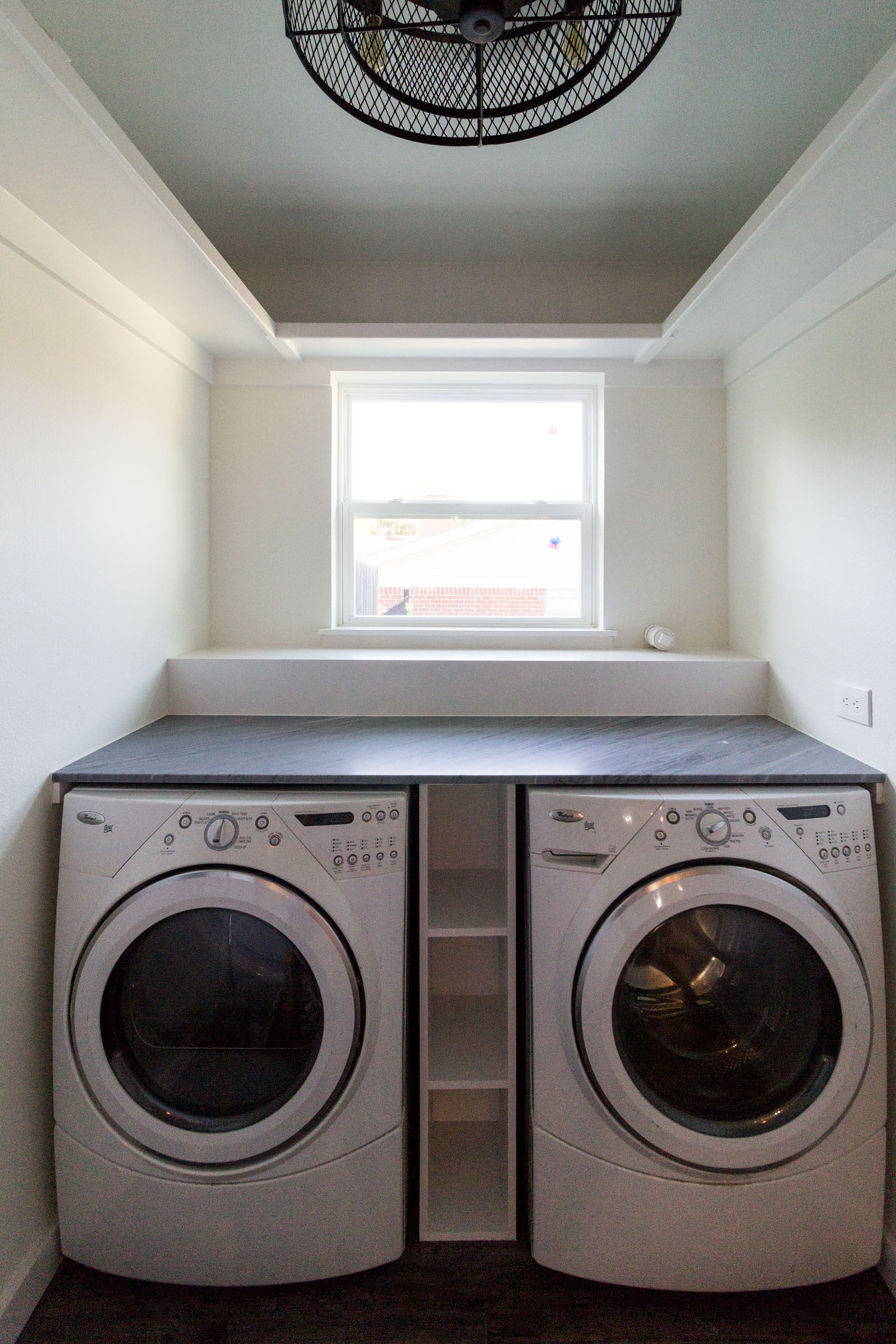 New laundry room, clean, minimalistic, white, washer and dryer, folding counter, window, built in storage