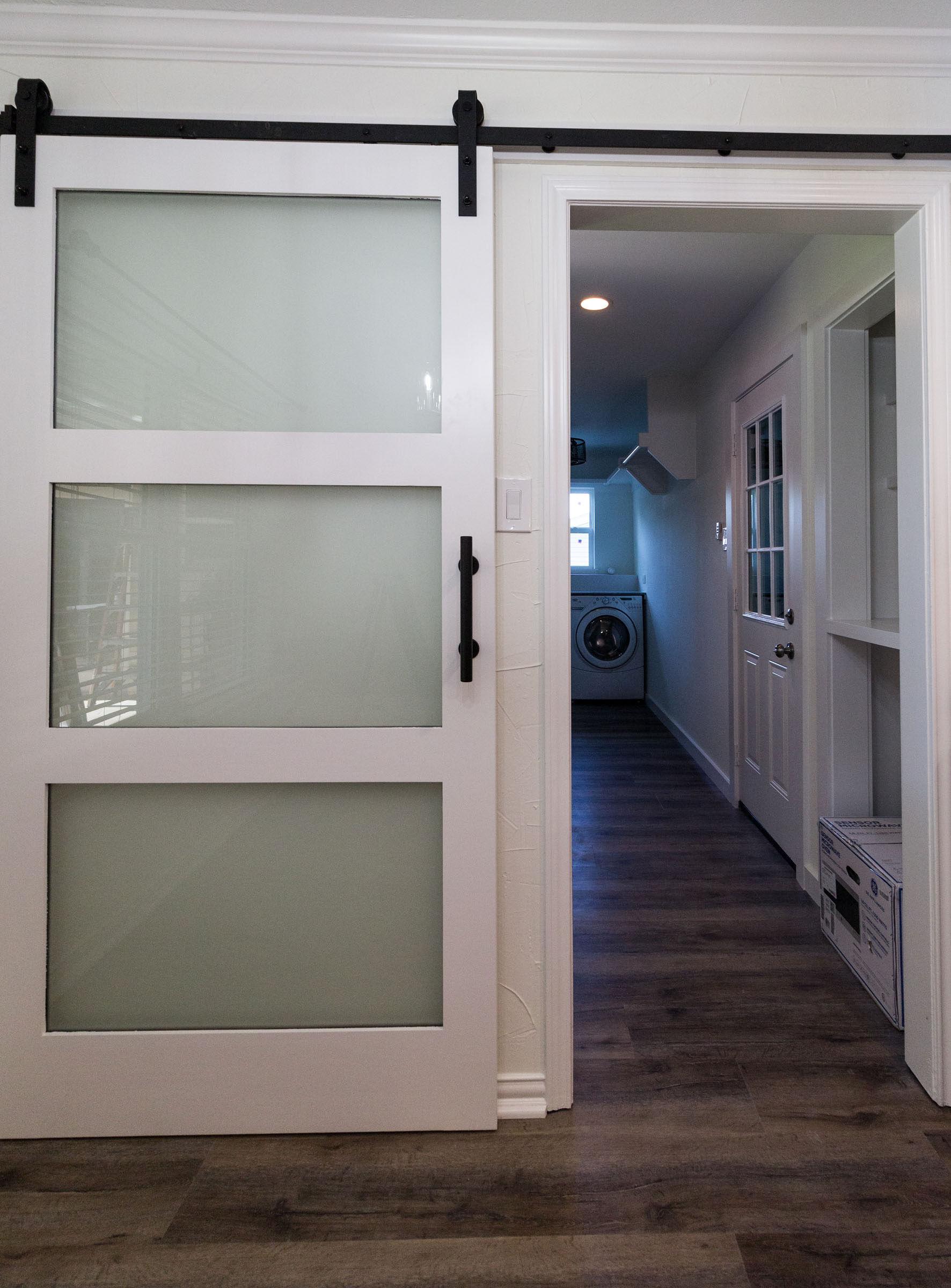 sliding glass barn door to laundry room remodel
