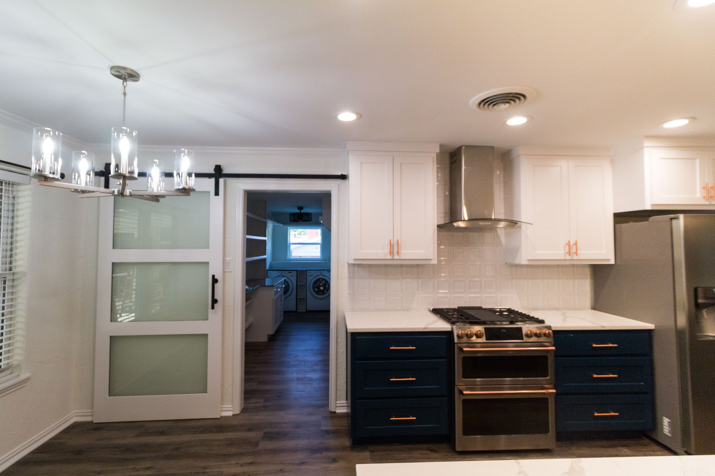Kitchen and laundry room remodel with sliding door and breakfast nook