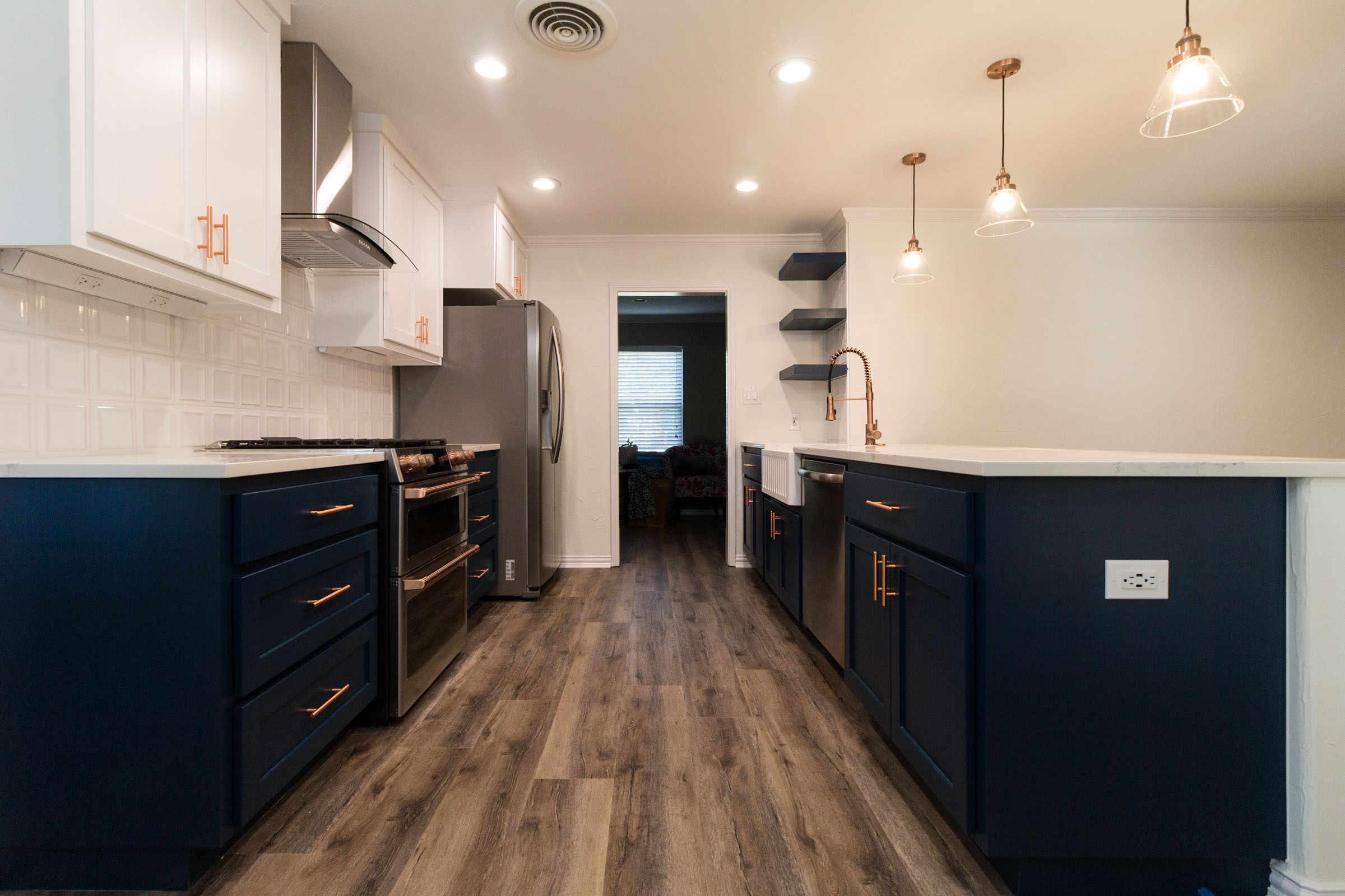 Kitchen renovation with colored cabinets and copper appliances