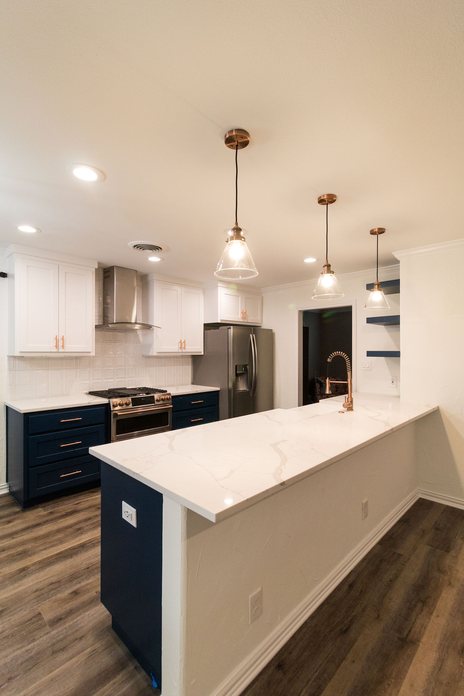 Open concept navy and copper kitchen remodel